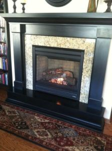 Gas fireplace as a focal point in townhouse.